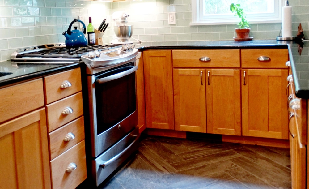 Textured tile flooring adds depth and personality to this thoroughly modern kitchen work space.