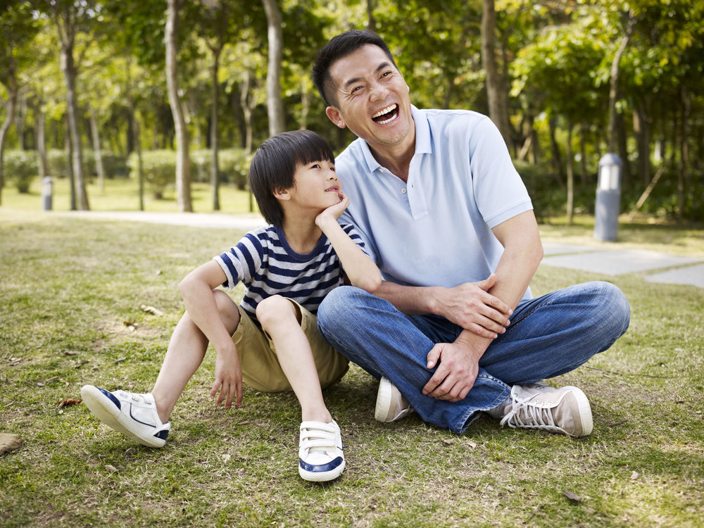 boy talking:laughing with dad.jpg