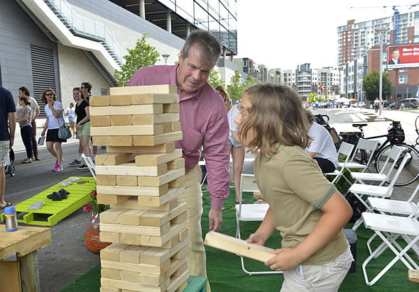 Open Streets Nashville encouraged spontaneous physical activity of all kinds, including games of giant Jenga with Mayor Karl Dean! (Photo courtesy of Metro Nashville)