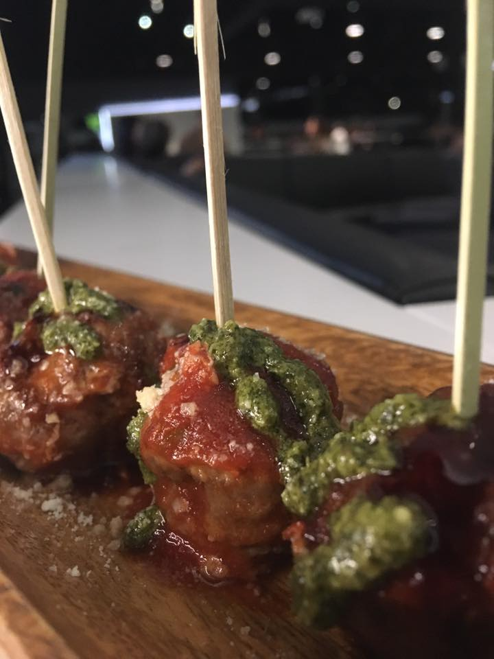 - Angus Beef Lollipops Topped With Parmesan Marinara & Pesto Sauce.
