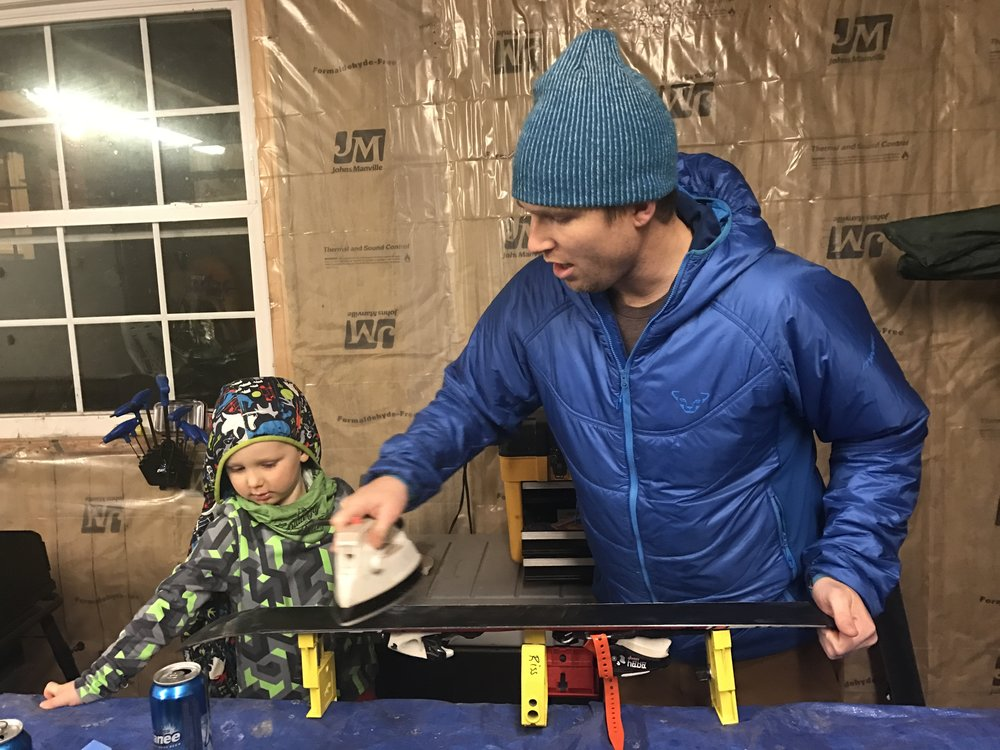 Dave Riss waxing his son's skis
