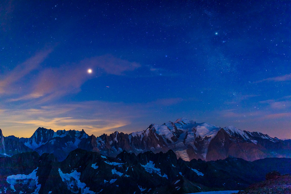 Mont Blanc with a rising moon and a few shining stars.