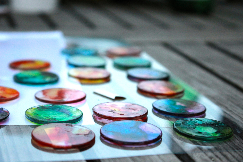 Pyropainted glass discs ready to be set in pendants.