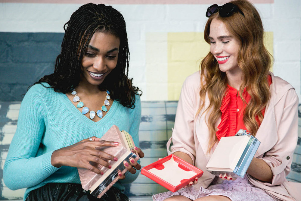 Models   Vanessa E'voen  (left) and   Kelsey Evenson   (right) demonstrate Modjewel's easy-to-use interchangeable faceplates.