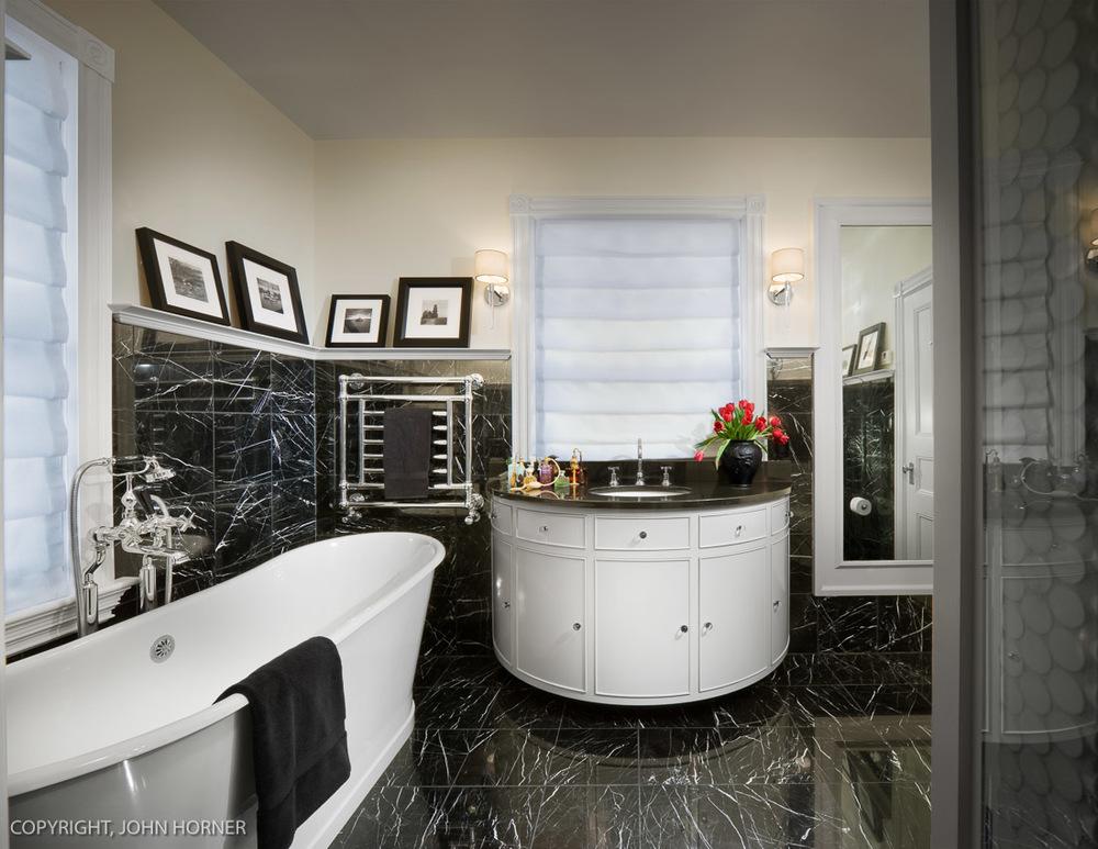 Master bathroom with custom round vanity.
