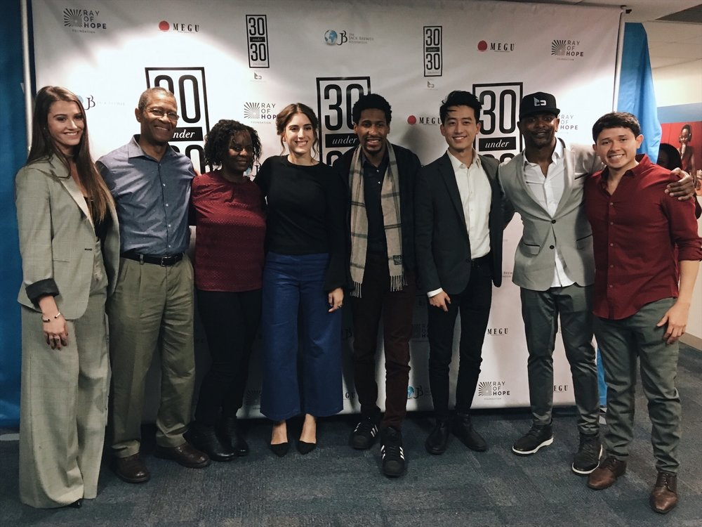 Opening Ceremony of 30Under30 Film Festival at UN Women Headquarters in New York City Left to right: 30Under30 Film Festival President Courtney Baxter, Mr. & Mrs. Batiste, Suleika Jaouad of New York Times, Jon Batiste of Late Show with Stephen Colbert, Artistic Director CheHo Lam, Jack Brewer of Brewer Media, 30Under30 Film Festival founder Sebastian Rea.