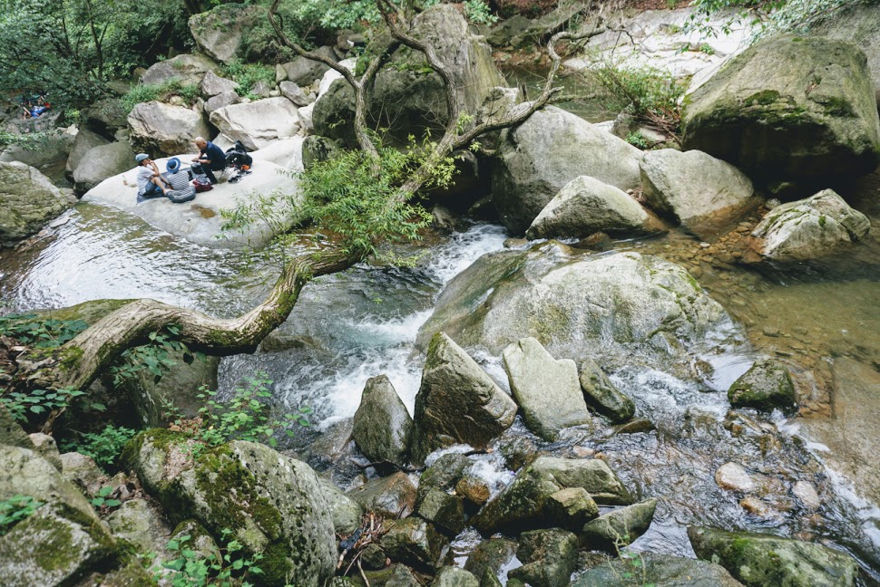 cooling off by the stream while hiking in bukhansan national park