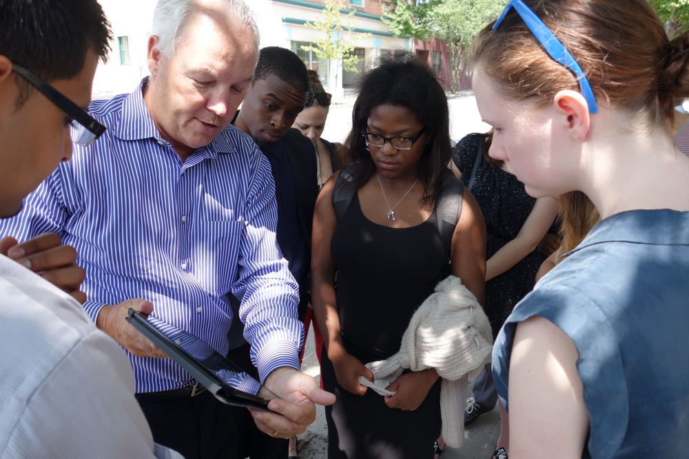 Dick Galvin shows 2014 interns site plans before touring the development site.