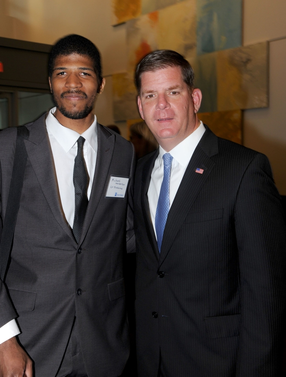 2014 CVP Intern Michael Henderson with Mayor Walsh at State Street Corp.'s ribbon cutting.