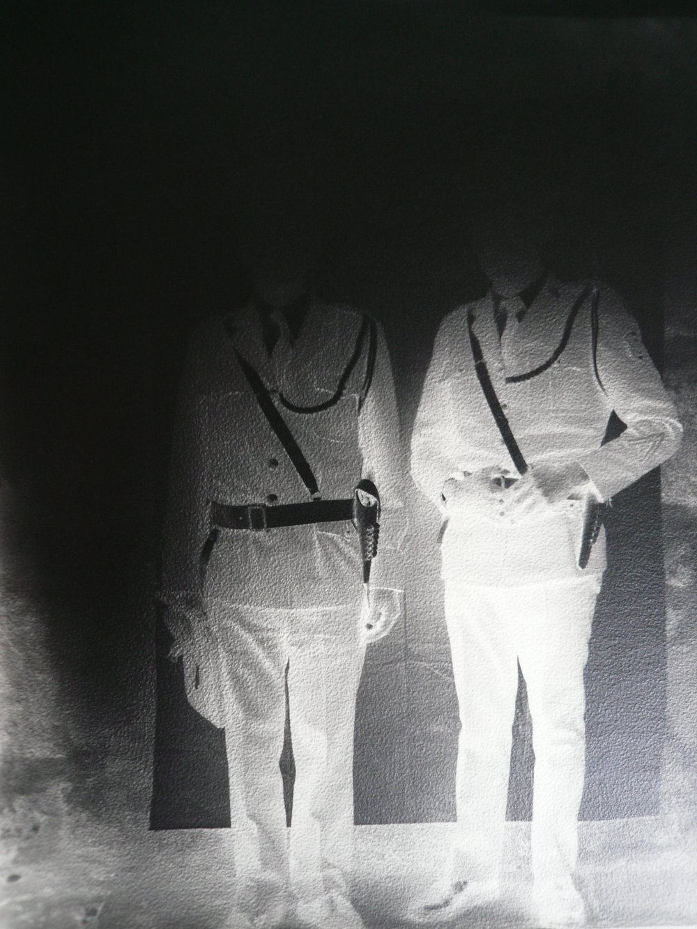 Image © Milagros de la Torre.   Under the Black Sun (Policemen)  , 1991-1993. Archival pigment print on cotton paper, mounted on aluminum. 80 x 60 in.