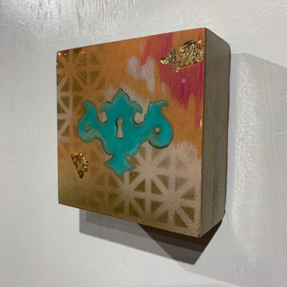 LeahGuzman_SacralChakra_2018_resin,acrylic,goldleaf_$100.00.jpg