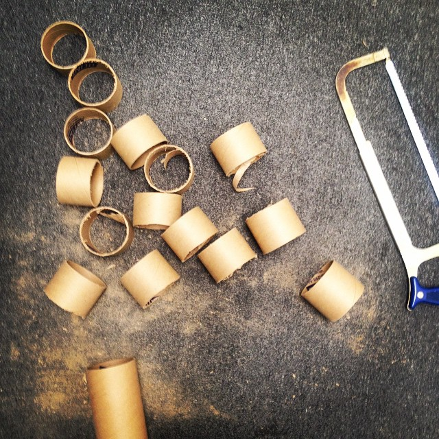 It's one of those days… Cutting down rolls so we can prepare for the next batch of large prints. #cut #hacksaw #rolls #printing #saw #cardboard #roughingit #dust #housestudios #tgif