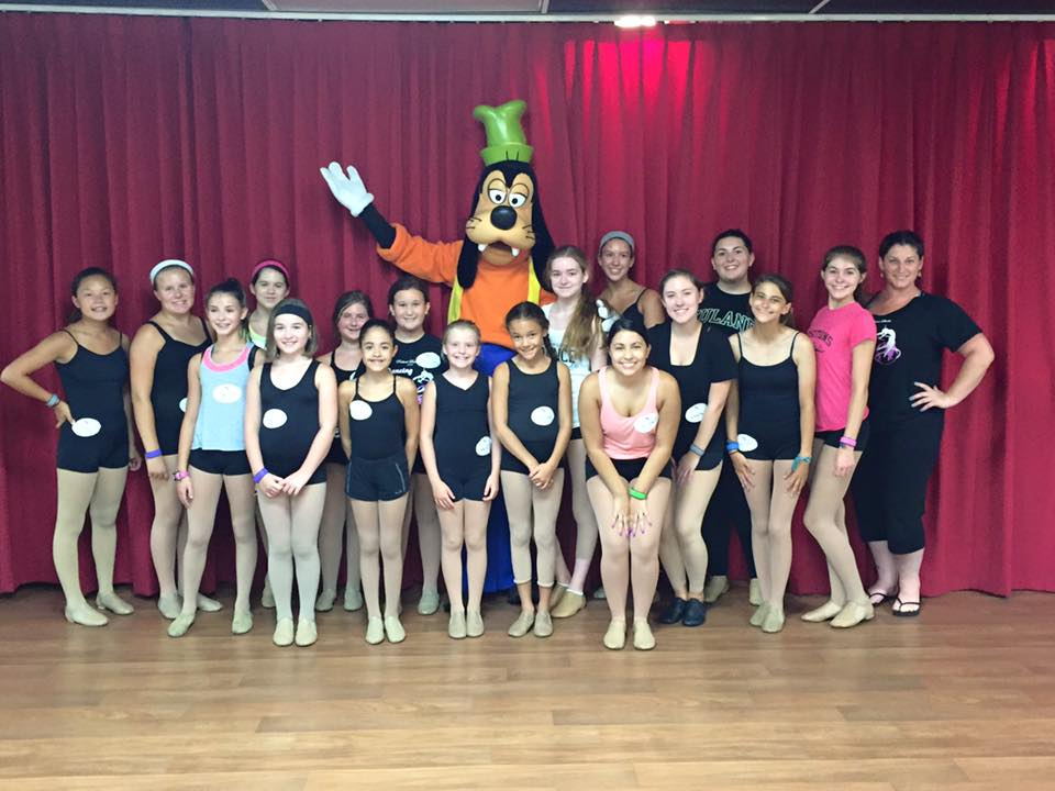 positions dance studio performance group members, miss rebecca, & goofy!