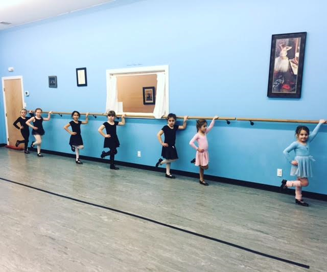 One of our ballet/tap/jazz combo classes learning shuffles at the barre!