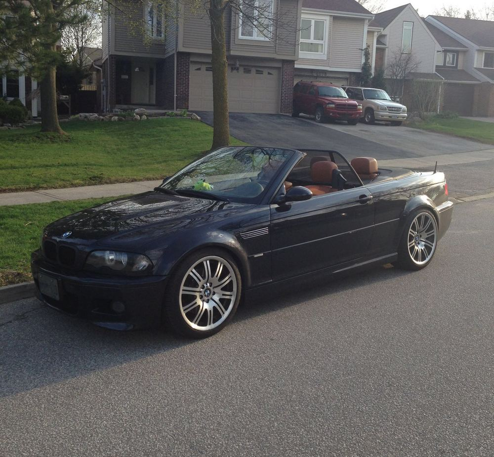 Actual photo of my 2004 E46 BMW M3 convertible. I miss those walnut seats and 333BHP!