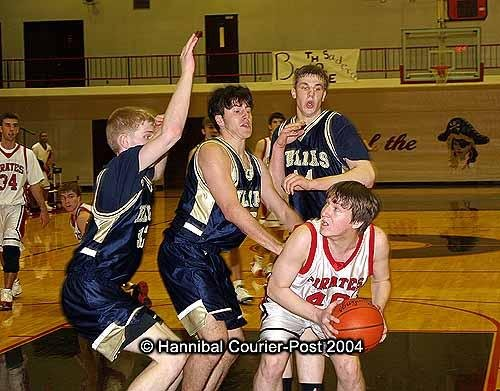 I couldn't dig up any pictures of Patrick playing hoops in high school, so here's proof of my Chips Ahoy-addled high school body trying to play basketball. Why didn't my parents tell me to get my haircut?