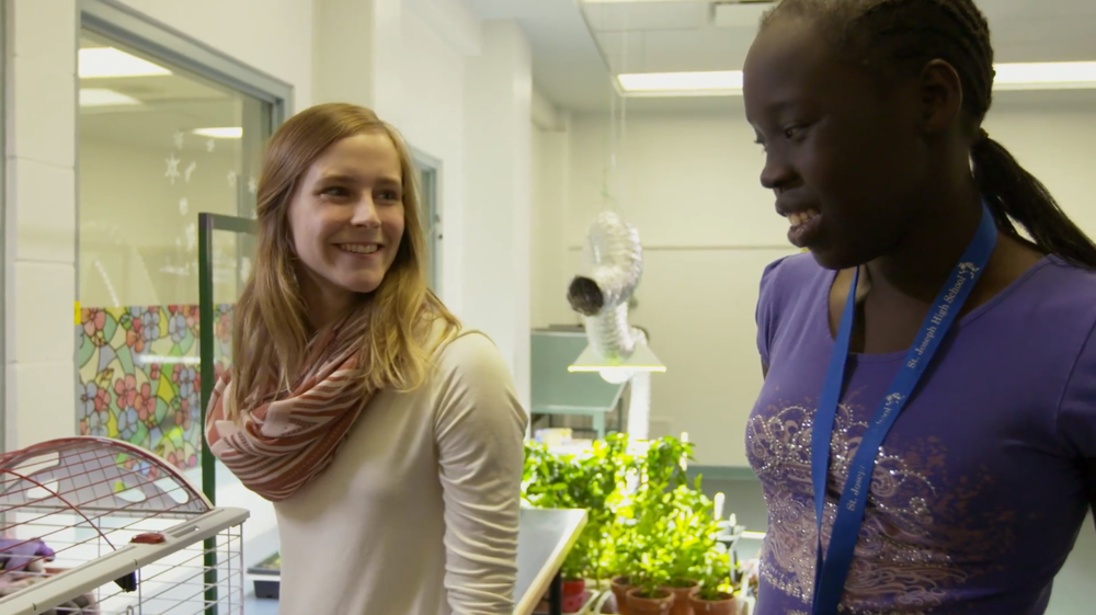 """[Photo: """"Sustainable Me"""" host Paula Humby with a student member of the Green Thumbs program at St. Joseph High School. The program is put on by Sustainable Food Edmonton. (Photo taken from the series, with permission)]."""