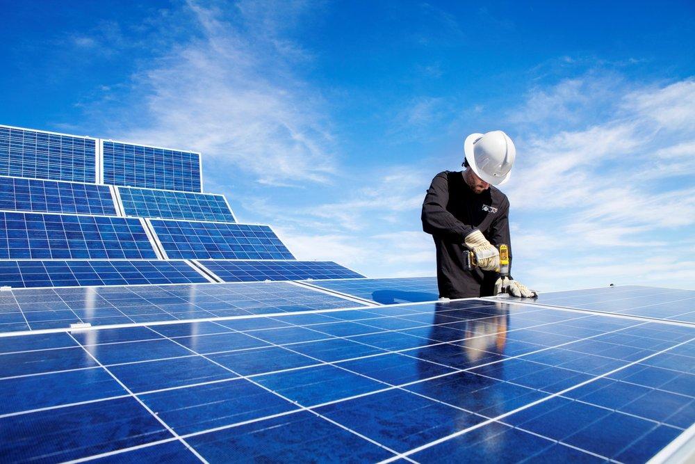 A NAIT student installing a solar array