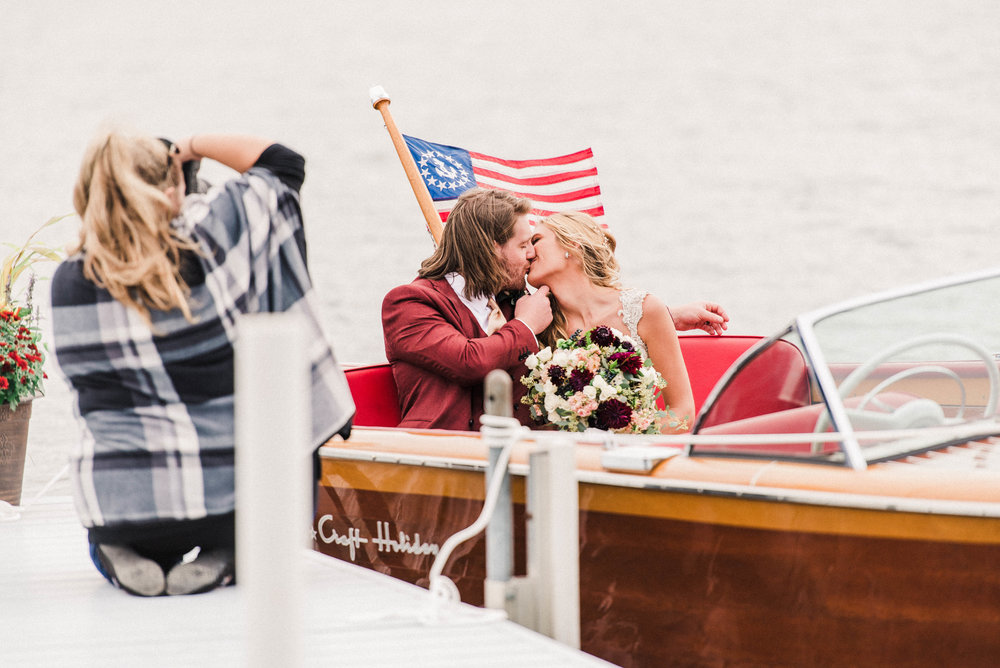 Kat photographing this adorable bride and groom in a custom boat that gave us all the Mamma Mia: Here We Go Again vibes!