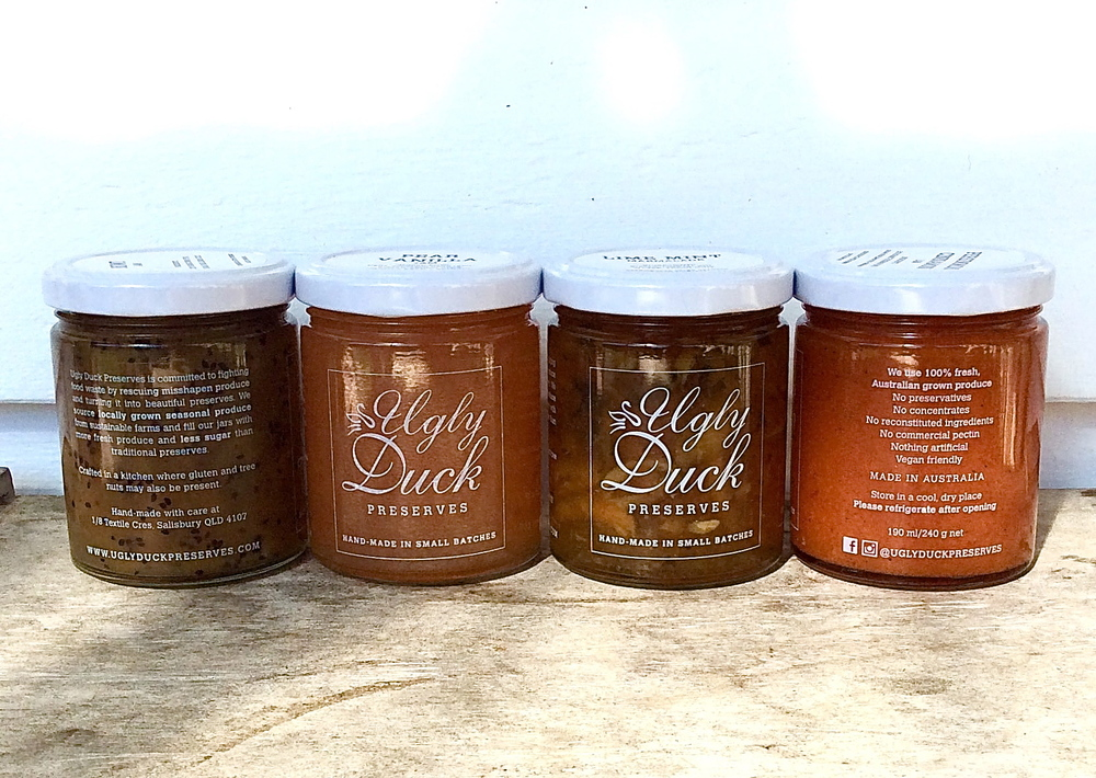 Ugly Duck Preserves jam jars with clear labels.