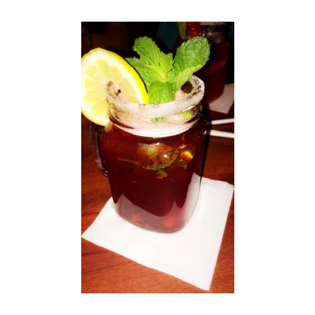 Blackberry Peach Tea Crush: Deep Eddy Peach Vodka, Muddled Fresh Blackerries,                     Peaches & Mint Leaves with Simple Syrup, Unsweetened Iced Tea, garnished with a                                                          Lemon Wheel & Mint, Sugar Rim