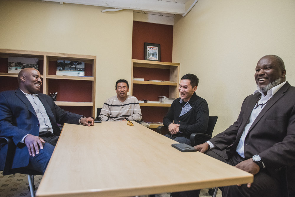Attorney  Keith Wattley speaks with Ke, Eddy, and Troy, former clients at UnCommon Law.
