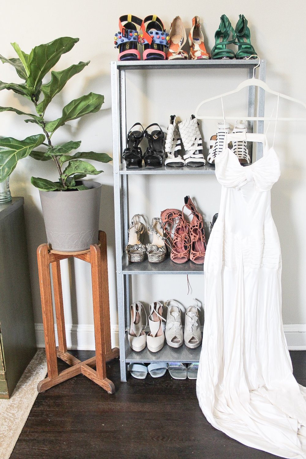 Thrifted : wedding dress, YES people this will be my actual wedding dress when the day comes and I scored it for $6 from the thrift. A few pair of shoes pictured here are thrifted and the plant stand is from an estate sale.