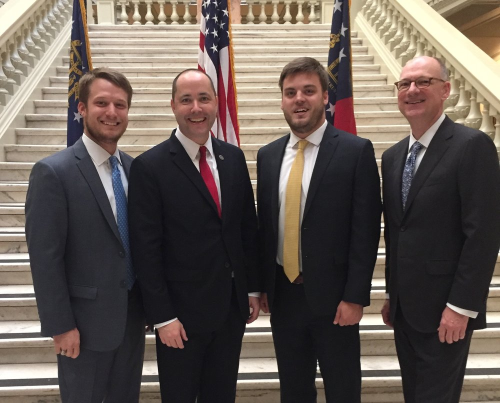 The Jl morgan company team stands with georgia attorney general chris carr at his swearing in ceremony on november 1, 2016.