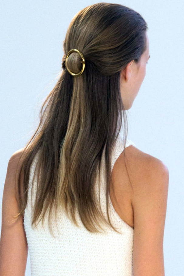 Blow-dry your hair with a large round brush, once dry lightly spray with some dry shampoo/ texturising spray. Section the hair from the tops of the ears up towards the crown and gather loosely as if you are doing a ponytail and secure with your clip.. Don't stress, you may need a couple of try's to get this perfect!! Once in place, smooth any fly aways with a light mist of hairspray.