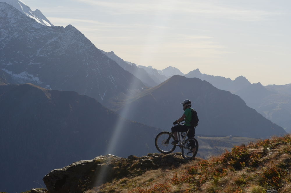 Mountain biking in the high Alpine pastures of the French alps
