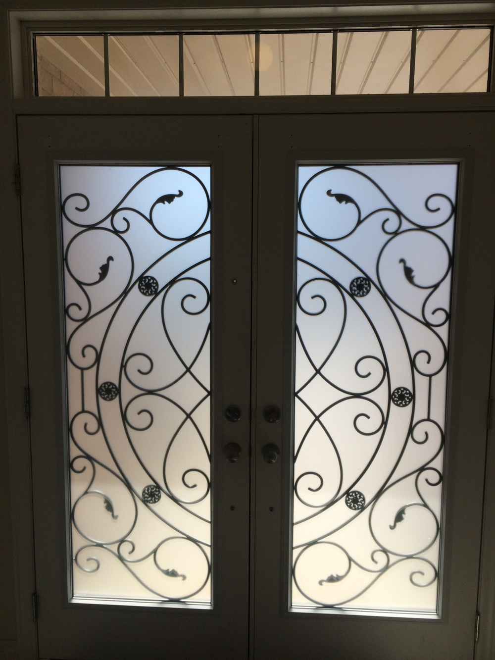Whitfield-wrought-iron-glass-door-inserts-installtion-in-vaughan-on