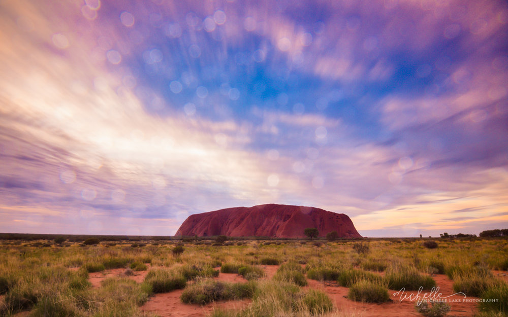 Sun showers and sunrise at Uluru