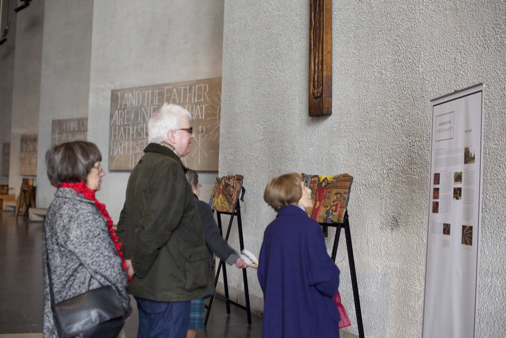 Parishioners seeing Stations of the Holocaust in Coventry Cathedral