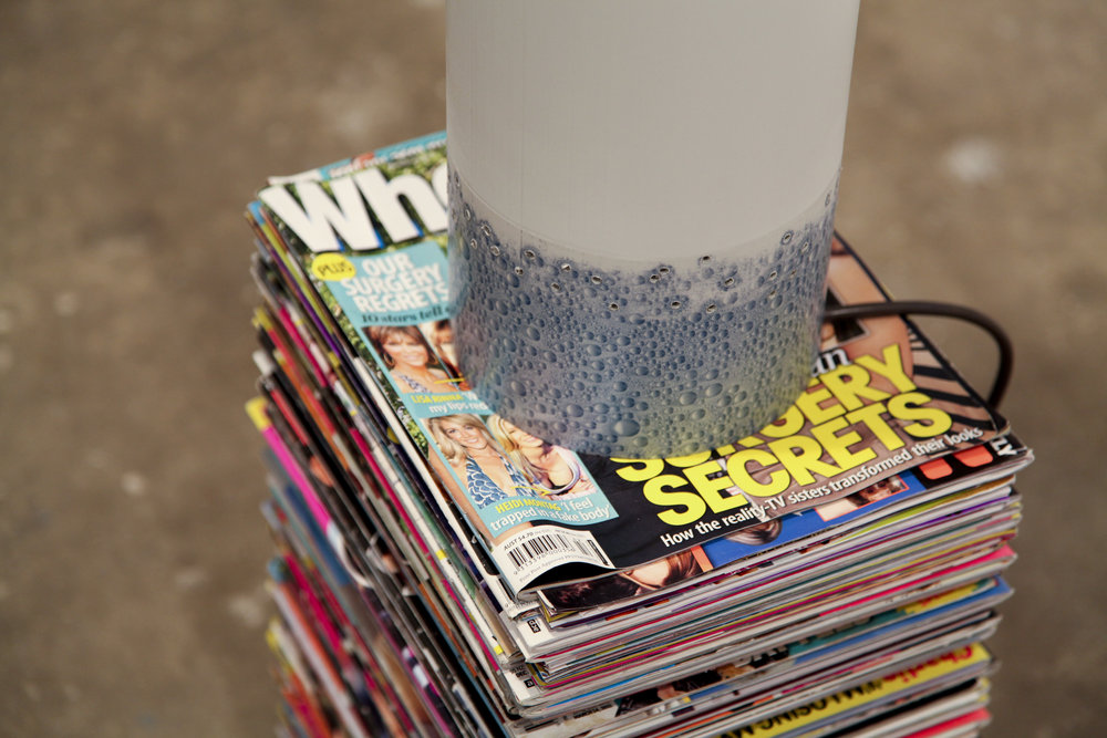 Earth, Water, Air , 2013, tabloid magazines (artist's personal collection), PVC pip, printed adhesive vinyl, Dyson Air Multiplier, installation view, MOP Projects, Sydney. Photography: Michael Randall. Copyright JD Reforma