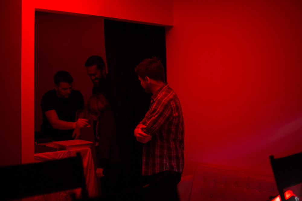 Developing plates in a makeshift darkroom. [Image credit: Lee Howell]