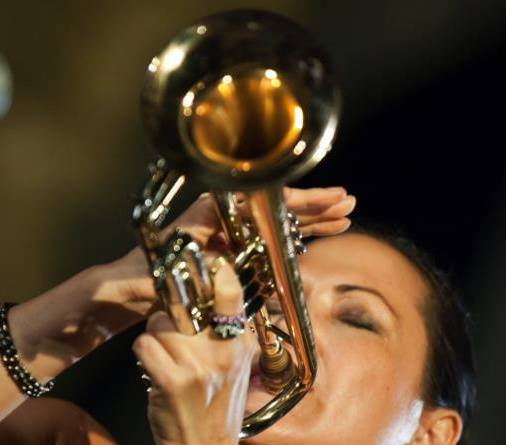 The talented Kiku Collins playing trumpet in Palermo, Italy. Photo: Arturo Di Vita