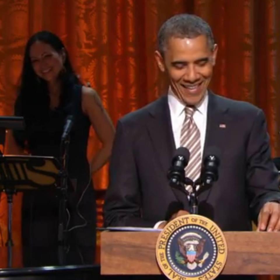 Kiku playing with President Barack Obama. Photo: Kiku Collins