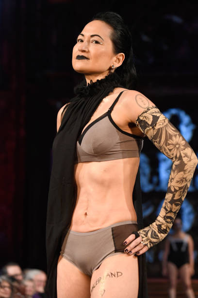 Kiku on the AnaOno Intimates x   #Cancerland runway during New York Fashion Week. (That's me in the swimsuit behind her!) Photo: Arun Nevader/Getty Images