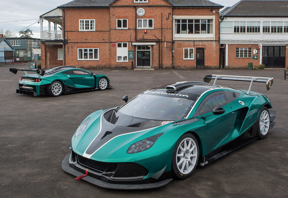 A-pair-of-Arrinera-Hussarya-GTs-outside-the-Clubhouse-at-Brooklands.jpg