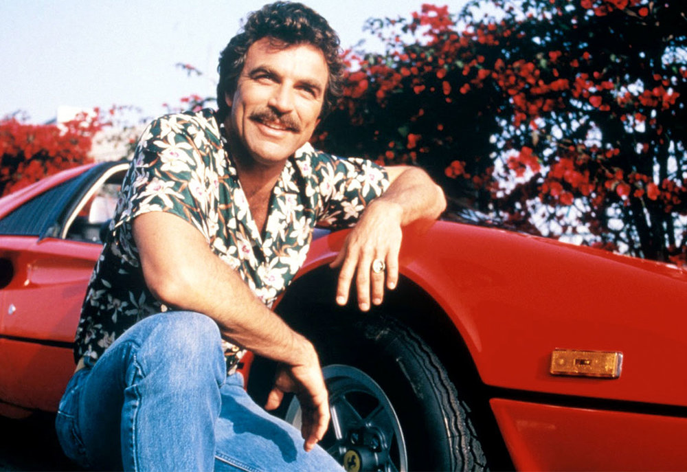 Tom Selleck as Magnum with his trademark Ferrari 308. Photo ©CBS