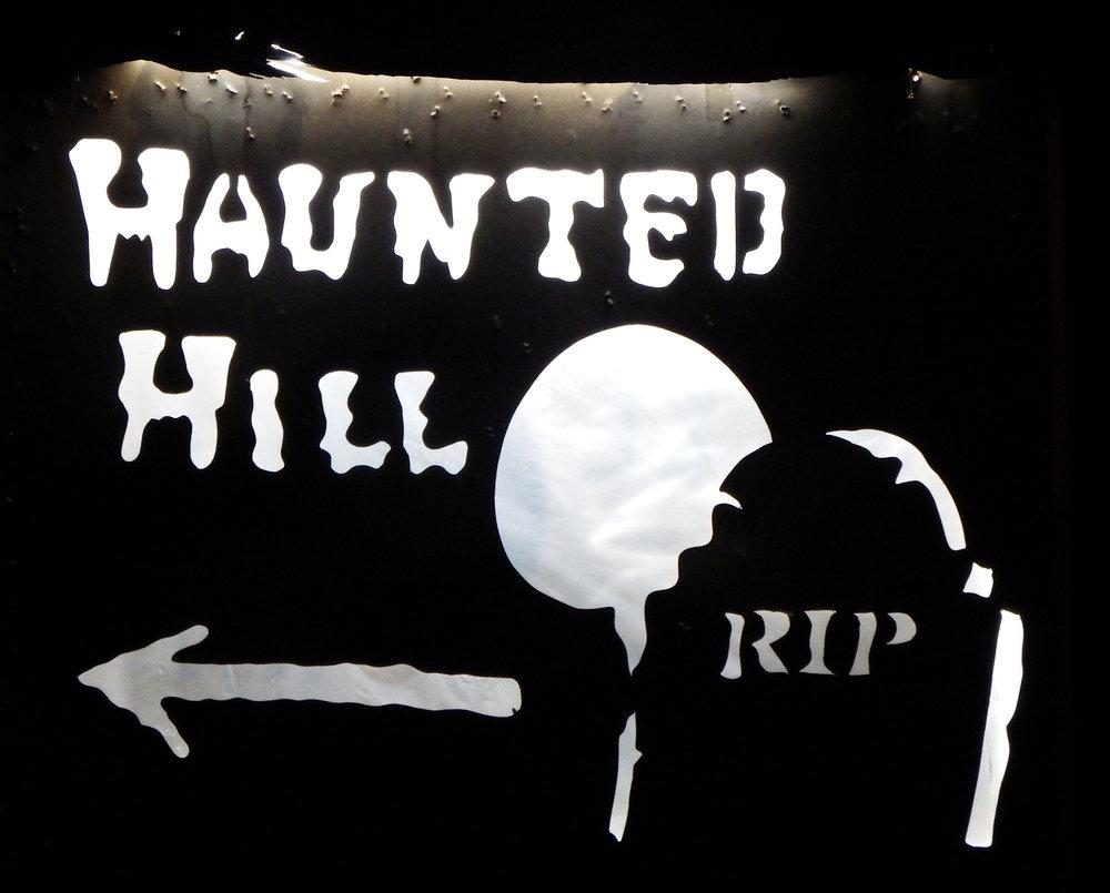 signhauntedhill.jpg