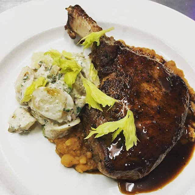 Berkshire pork chop | Mashed bbq baked yellow eyed peas, herb potato and pickled sunchoke salad, celery leaf