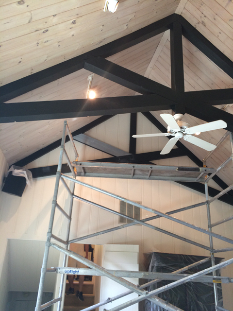 Painted beams in progress with the still white walls and pickled pine ceiling.