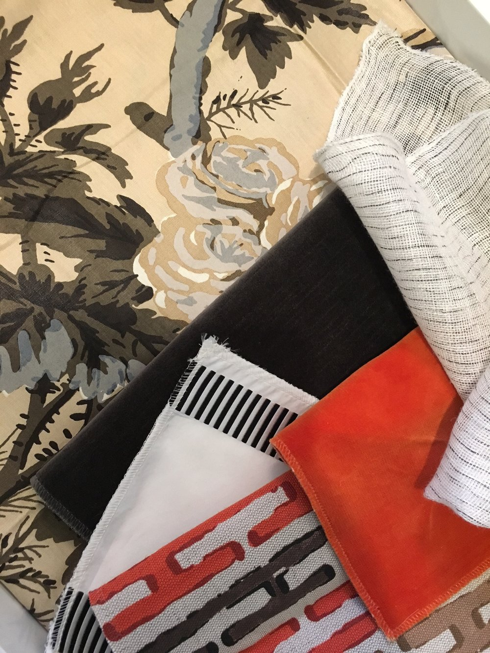 I posted this festive scheme this morning to Instagram.  I could see this making a beautiful den or library with the tobacco stained chintz as curtains with the gauzy sheers behind, orange velvet club chairs, striped silk pillows, black lacquered walls, a sisal rug, and lots of brass and wood accents.