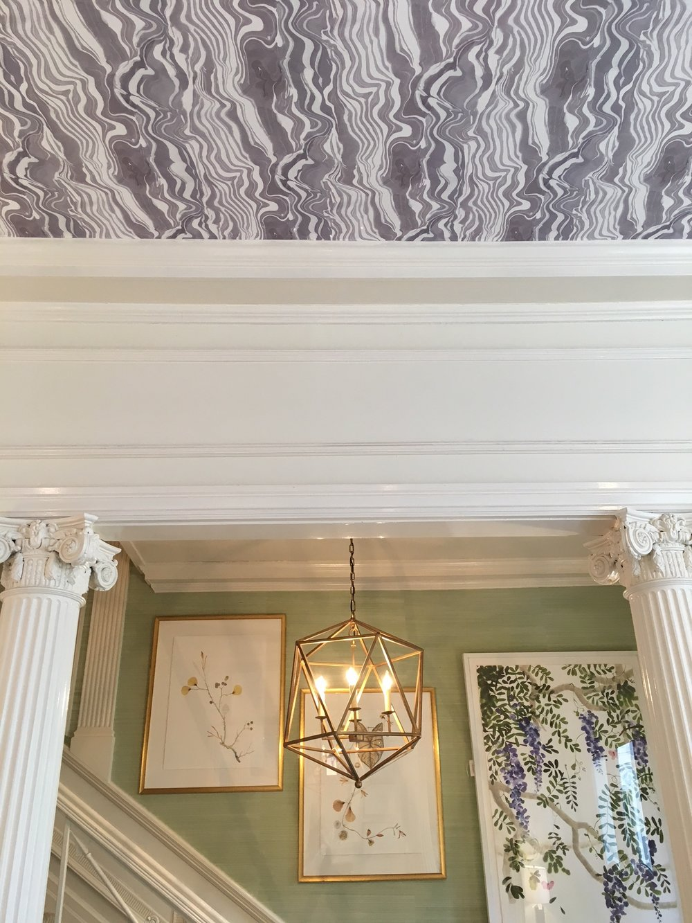 One of the Rebecca Atwood wallpapers we saw at James, shown here on the ceiling. So cool.