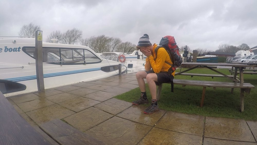Failing the Thames Path- an image of Jago sat on bench with face in his hands