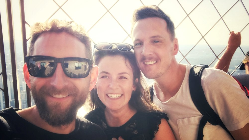 Image of Dan on the top of the Eiffel Tower with 2 friends