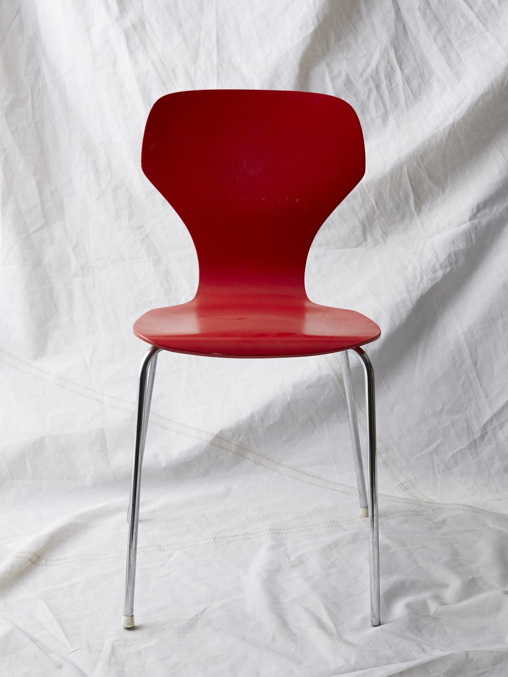 "CH018  Arne Jacobson style red chair 32"" H x 18"" W x 19"" D  $75/week"
