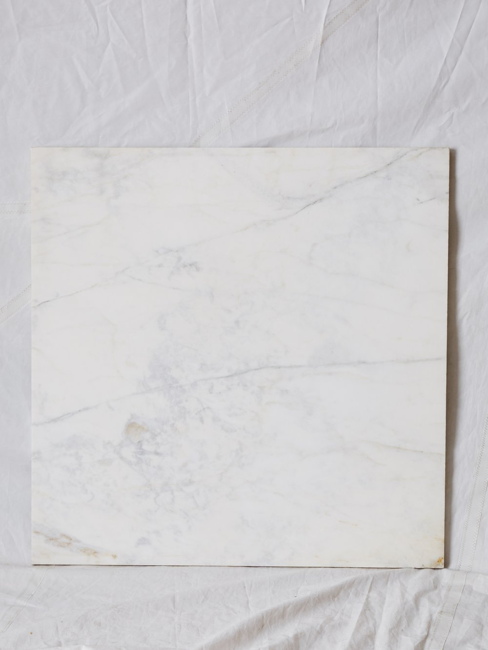"PMB001 HONED CARRARA 36"" x 36"" $350/week"