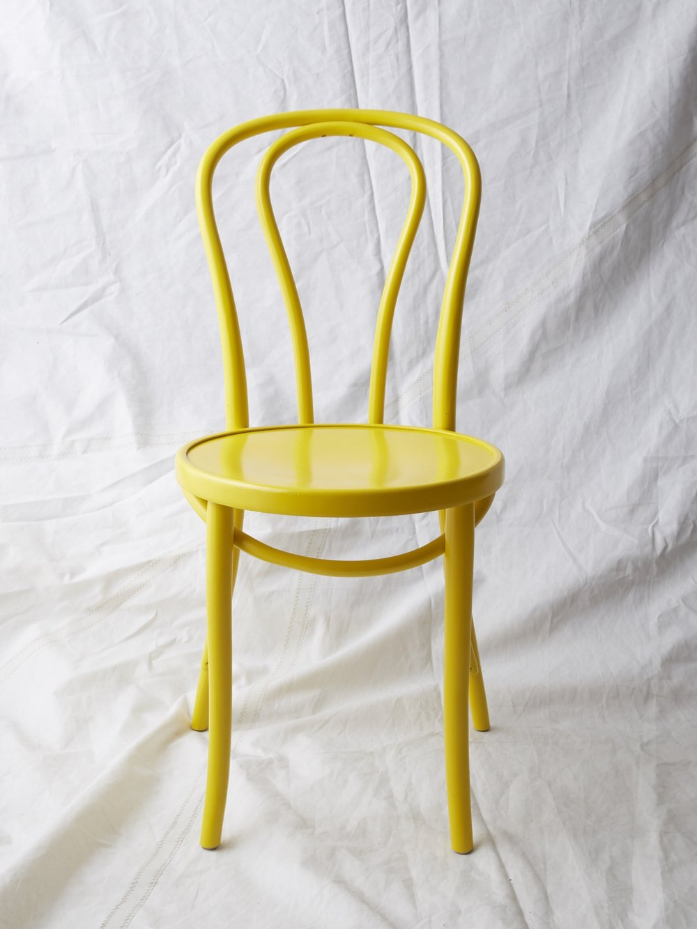 """CH021 Yellow painted Thonet chair 35"""" H x 16"""" W x 20"""" D $75/week"""
